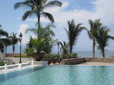 Heated Infinity Pool with Swim-Up Restaurant and Bar Overlooking Beach and Ocean