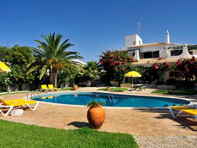 Photo for A superb 5-bedroom villa with wonderful large tropical lawned gardens,  just a short 3-minute stroll