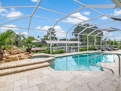 Photo for Ultimate Outdoor Living! Luxurious Yacht Club Area Pool Home! Gulf Access Canal! Kayaks & WiFi!