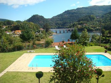 House with private pool, on the shore of a brilliant lake, sublime beauty.