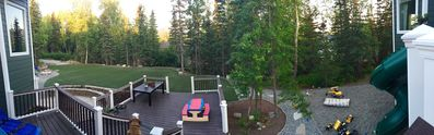 Panoramic view of the backyard and decks