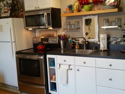 Kitchen with full size appliances and just about any cooking device needed