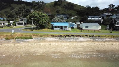 Absolute beachfront with single lane residents access road in front