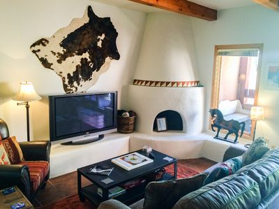 """50"""" flat screen and Kiva fireplace. Cozy up on those chilly Santa Fe nights."""