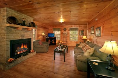 Lovely Living Room - Now featuring new sleeper sofa. Enjoy TV with your family or friends during your vacation on every level of your cabin. This cabin is just 2 miles to the Pigeon Forge strip!