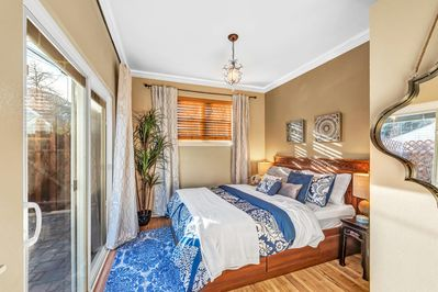 Bedroom 3 with Queen bed has sliding door access to private fenced patio.