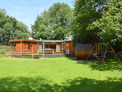 Photo for Detached wooden chalet with sauna and jacuzzi at the Nature Park Maashorst