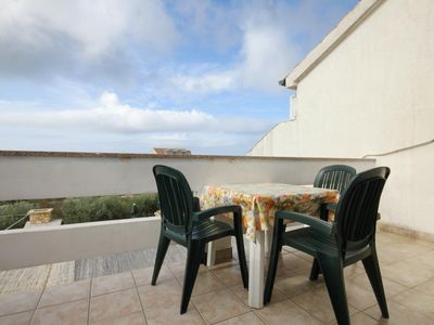 Photo for One bedroom apartment with terrace and sea view Novalja, Pag (A-9335-b)