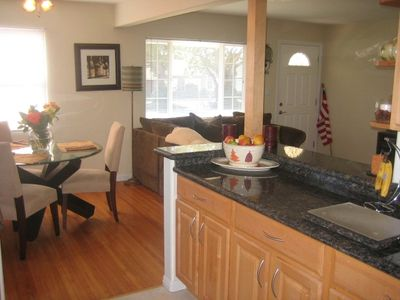 The gourmet kitchen offers granite and stainless