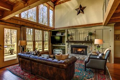 Great room with vaulted ceilings and windows.