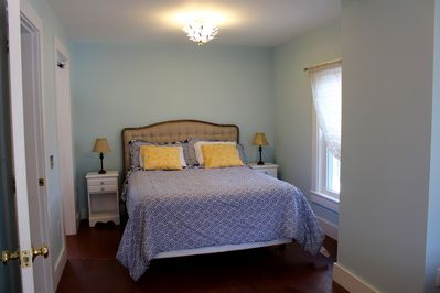 The other side of the back bedroom hosts a walk-in closet and a queen bed.