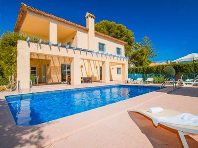 Photo for 4 bedroom Villa, sleeps 10 with Pool, FREE WiFi and Walk to Beach & Shops