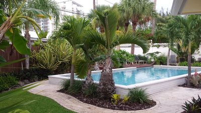Heated in ground 15x30 pool, tropical landscaping, marble pavers, lounge chairs.