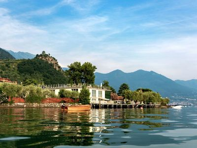 Photo for Modern apartment, directly on Lake Iseo. Terrace with sunscreen, airconditioning