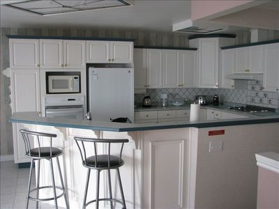 Spacious kitchen fully loaded with all your cooking needs