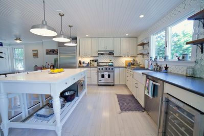 Gourmet kitchen with high end appliances fully stocked with cookware & flatware