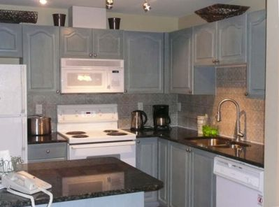 New granite counters, stainless dishwasher, fully stocked kitchen. Wireless!