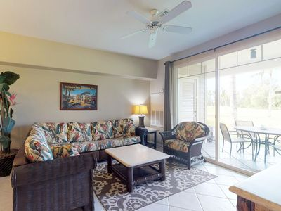 Photo for NEW LISTING! Amazing golf-course front condo w/lanai, AC & shared pool/hot tub