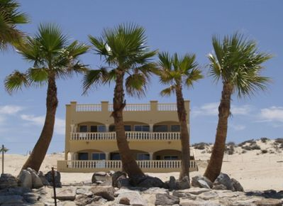 View of the house from the beach. Nothing but palms between you and the beach.