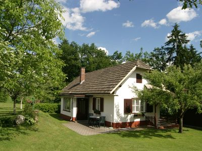 Photo for Nice white bungalow, located in sunny nature setting.