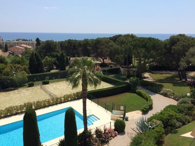 Photo for Modern apartment with pool + tennis, quiet, overlooking park and sea