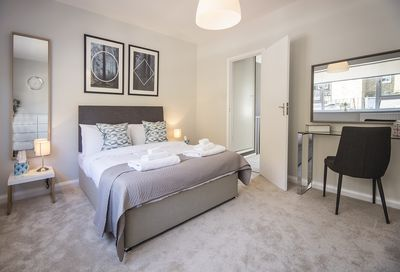 The stunning master bedroom with a UK king-size bed and an abundance of storage