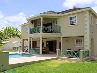 Photo for 4 Bed Colonial Style Villa in private setting, short walk to beach