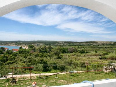 Photo for Two bedroom apartment with terrace and sea view Caska (Pag)