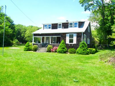 Photo for In the Village, walk to town! Great porch and huge yard!