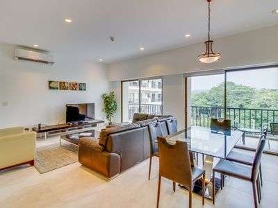 Photo for Stylish and modern condo just moments from the beach!