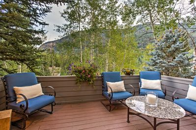 Wake up to mountain views every morning from this vacation rental's balcony.
