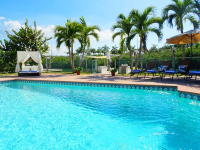 Photo for Stunning Waterfront Pool Home Walk to Beach & Restaurants Large Private Pool
