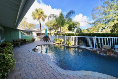 Heated saltwater pool & patio is shared with attached 2 BR unit. Seating for 12
