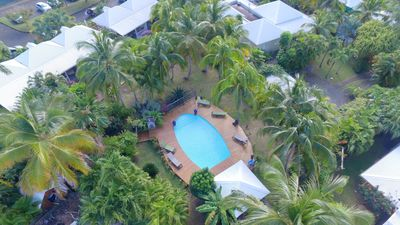Photo for air-conditioned bungalows in a tropical park with swimming pool and carbet