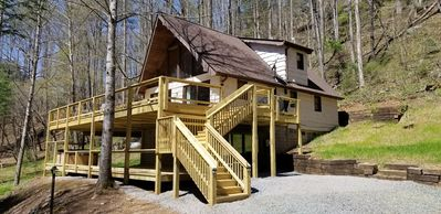 Photo for Private Cabin on 11 acres, 1500ft of Stocked Trout Stream, WIFI, Hot tub