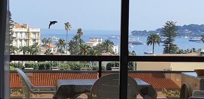 Photo for Centre of Beaulieu, 3 air conditioned rooms, calm, terrace, sea view, swimming pool and garage.