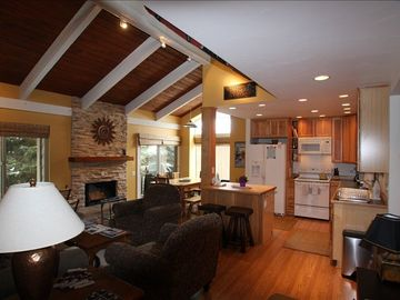 Open Cathedral Ceiling Living Area With Wood Burning Fireplace For Your Comfort