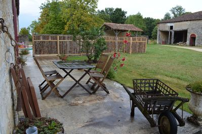 the patio again, with the pool in the distance behind the fence
