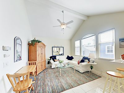 Living Room - High ceilings and big windows provide plenty of natural light in this charming upstairs apartment.