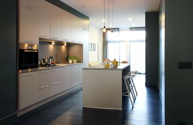 The bespoke open kitchen is both contemporary and practical, including a refrigerator, dishwasher, an oven, a microwave and and Nespresso machine to wake you up and enjoy Brussels.