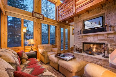 Luxurious high-ceilinged comfort and a warm gas fireplace in the living room
