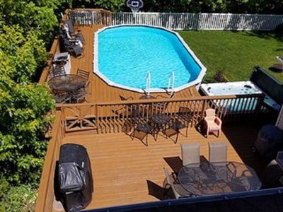 Yard has it all...large heated pool, large deck, hot tub, beautiful landscaping