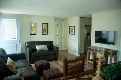 From the front door you'll arrive in the living room with a dining area.