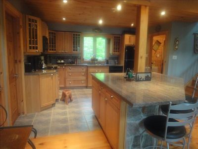 Spacious kitchen with granite and center island