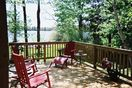 Beautiful deck overlooking patio, beach, and lake