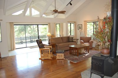 Living Room with cathedral ceilings and expansive deck and views.