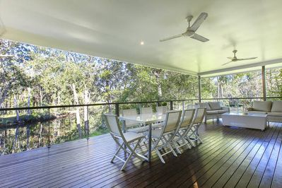 The deck is under the roofline with a really comfortable lounge suite and dining