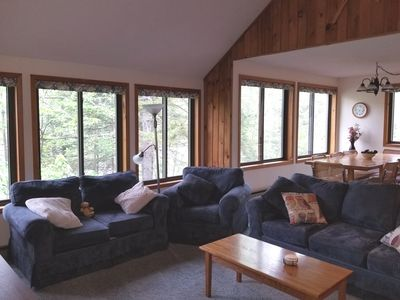 Windows all around, with beautiful wooded views.