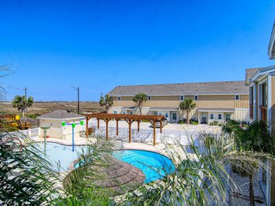 Photo for NEW LISTING! Pool view townhouse w/shared pools & playground - close to beach!