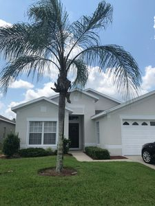 Photo for Beautiful home w/ south facing pool in gated community just minutes from Disney!